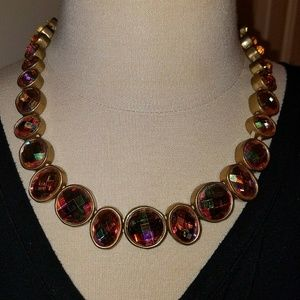 Costume jewelery necklace, gold colored stones